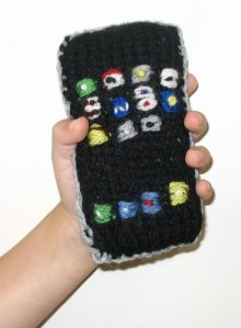 http://blog.craftzine.com/archive/2007/07/knit_iphone.html